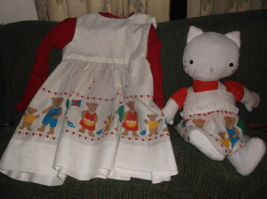 This dress was SO quick and easy to make, especially since the hem was ready-made. For the kitty's dress, I used the valance, so the only sewing I had to do was to add the straps and make a velcro closure on the back.